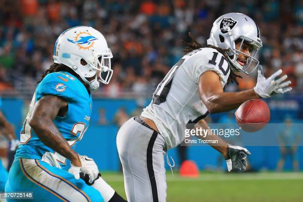 Wide receiver Seth Roberts of the Oakland Raiders attempts to make a catch against the Miami Dolphins at Hard Rock Stadium on November 5 2017 in...