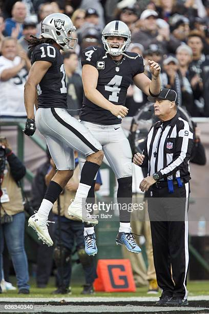 Wide receiver Seth Roberts of the Oakland Raiders celebrates a twopoint conversion catch on a pass from quarterback Derek Carr of the Oakland Raiders...