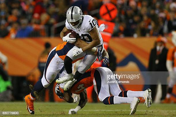 Wide receiver Seth Roberts of the Oakland Raiders is tackled after catching a pass in the fourth quarter of the game against the Denver Broncos at...