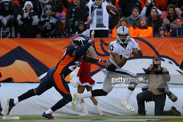 Wide receiver Seth Roberts of the Oakland Raiders makes a catch for a third quarter touchdown against the Denver Broncos under coverage by free...