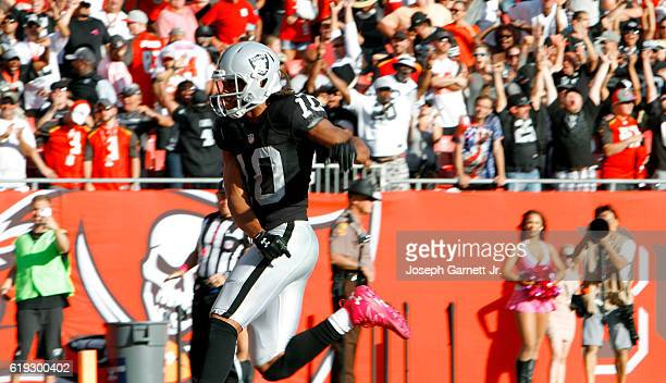 Wide receiver Seth Roberts of the Oakland Raiders runs out of the back of the end zone after scoring the winning touchdown in overtime against the...