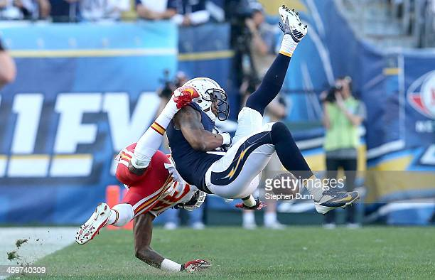 Wide receiver Seyi Ajirotutu of the San Diego Chargers can't hold on to a pass as cornerback Ron Parker of the Kansas City Chiefs defends at Qualcomm...