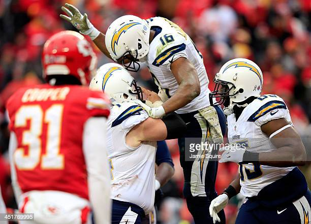 Wide receiver Seyi Ajirotutu of the San Diego Chargers is congratulated by teammates after catching a pass for a touchdown in the final minute of the...