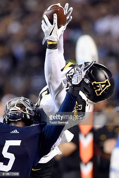 Wide receiver Shaedon Meadors of the Appalachian State Mountaineers pulls down a reception over cornerback Darius Jones Jr #5 of the Georgia Southern...