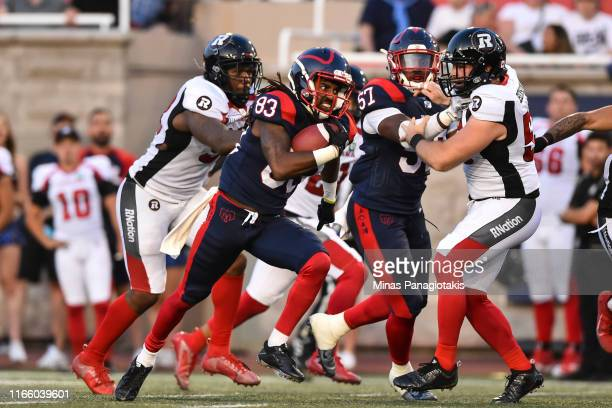 Wide receiver Shakeir Ryan of the Montreal Alouettes runs the ball against the Ottawa RedBlacks during the CFL game at Percival Molson Stadium on...