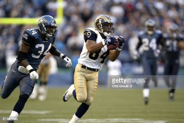 Wide receiver Shaun McDonald of the St. Louis Rams rushes for the winning touchdown in overtime against Terreal Bierria of the Seattle Seahawks at...
