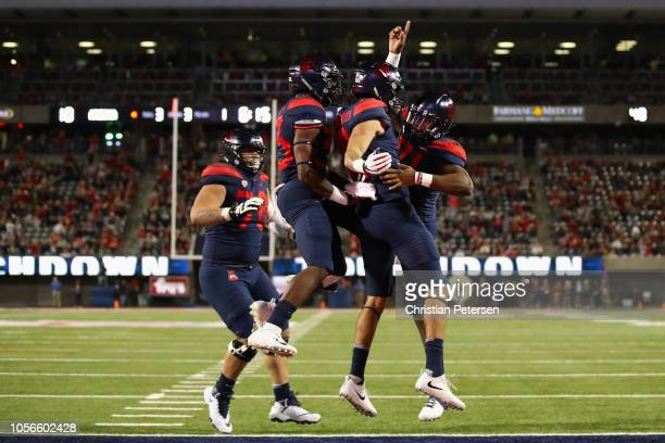 Wide receiver Shawn Poindexter and quarterback Khalil Tate of the Arizona Wildcats celebrate after Poindexter caught a one yard touchdown reception...
