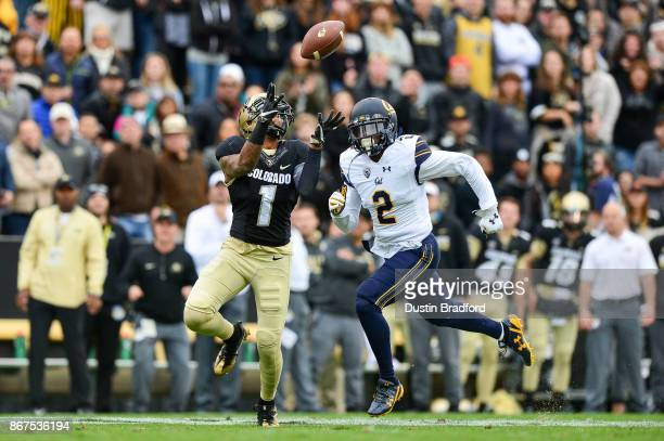 Wide receiver Shay Fields of the Colorado Buffaloes has a catch for a long second quarter touchdown under coverage by cornerback Darius Allensworth...