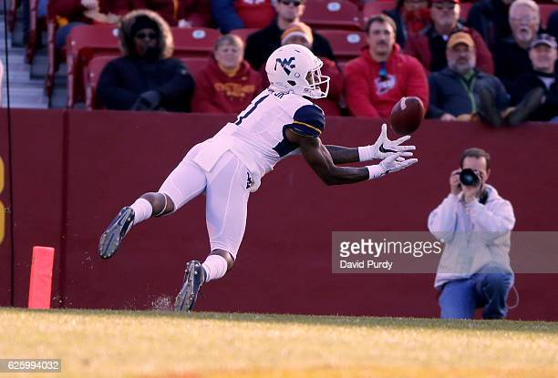 Wide receiver Shelton Gibson of the West Virginia Mountaineers pulls in a 50 yard pass in the first half of play against the Iowa State Cyclones at...