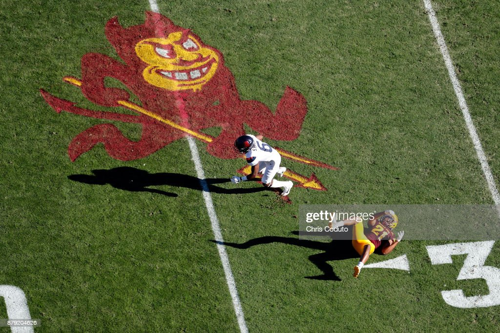 Wide receiver Shun Brown #6 of the Arizona Wildcats slips past defensive back Chad Adams #21 of the Arizona State Sun Devils during the first half of the college football game at Sun Devil Stadium on November 25, 2017 in Tempe, Arizona.