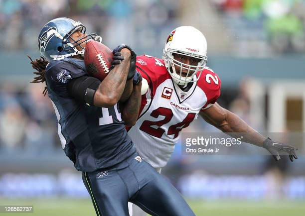Wide receiver Sidney Rice of the Seattle Seahawks makes a 52 yard catch against strong safety Adrian Wilson of the Arizona Cardinals at CenturyLink...