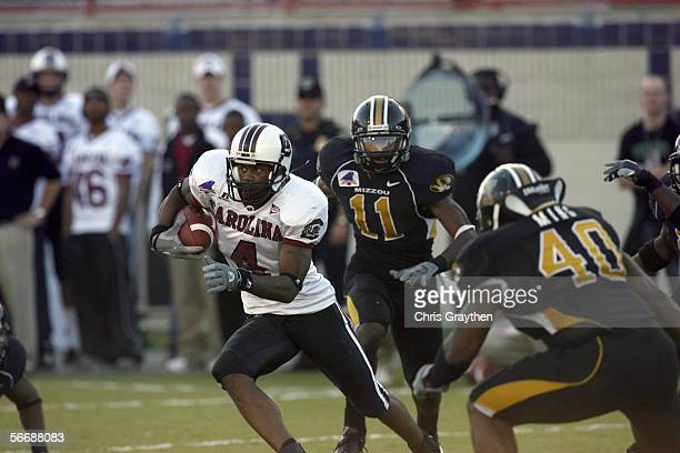 Wide receiver Sidney Rice of the South Carolina Gamecocks carries the ball against the Missouri Tigers during the Independence Bowl on December 30,...