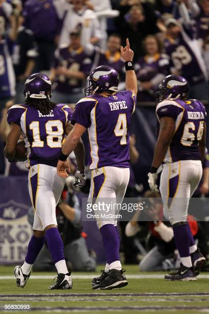 Wide receiver Sidney Rice quarterback Brett Favre and offensive guard Anthony Herrera of the Minnesota Vikings celebrate Rice's 45 yard touchdown...