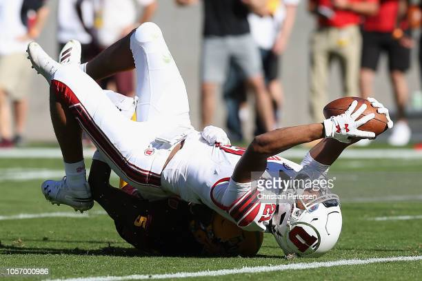 Wide receiver Solomon Enis of the Utah Utes makes a reception against the Arizona State Sun Devils during the first half of the college football game...