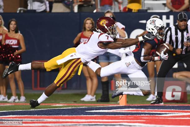 Wide receiver Stanley Berryhill III of the Arizona Wildcats catches a 33 yard touchdown in front of safety Marvell Tell III of the USC Trojans in the...