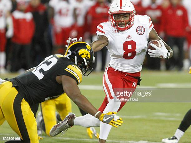 Wide receiver Stanley Morgan Jr #8 of the Nebraska Cornhuskers runs in front of defensive back Anthony Gair of the Iowa Hawkeyes during the third...