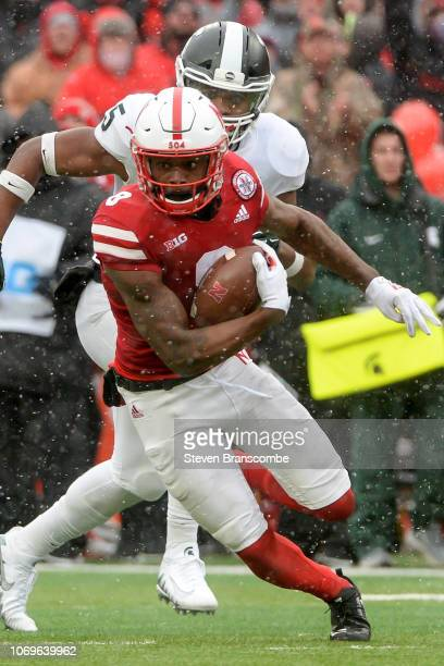 Wide receiver Stanley Morgan Jr #8 of the Nebraska Cornhuskers runs against the Michigan State Spartans at Memorial Stadium on November 17 2018 in...