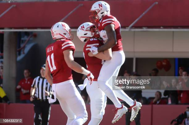 Wide receiver Stanley Morgan Jr #8 of the Nebraska Cornhuskers celebrates with tight end Kurt Rafdal and tight end Austin Allen after scoring against...