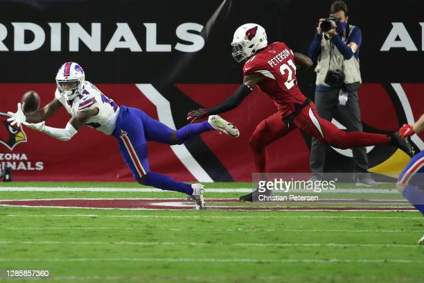 Wide receiver Stefon Diggs of the Buffalo Bills catches a touchdown pass to take the lead as cornerback Patrick Peterson of the Arizona Cardinals...