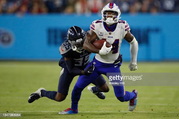 Wide receiver Stefon Diggs of the Buffalo Bills is tackled by defensive back Chris Jackson of the Tennessee Titans during the first half at Nissan...