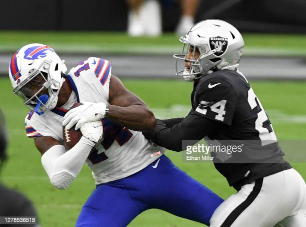 Wide receiver Stefon Diggs of the Buffalo Bills is tackled by strong safety Johnathan Abram of the Las Vegas Raiders after Diggs caught a pass for a...