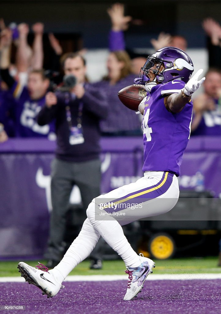 Wide receiver Stefon Diggs #14 of the Minnesota Vikings celebrates as he runs into the endzone for the game-winning touchdown as the Vikings defeat the New Orleans Saints 29-24 to win the NFC divisional round playoff game at U.S. Bank Stadium on January 14, 2018 in Minneapolis, Minnesota.