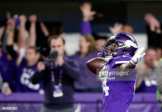 Wide receiver Stefon Diggs of the Minnesota Vikings celebrates as he runs into the endzone for the gamewinning touchdown as the Vikings defeat the...