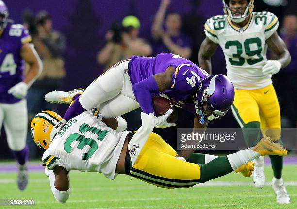 Wide receiver Stefon Diggs of the Minnesota Vikings is tackled by strong safety Adrian Amos of the Green Bay Packers during the game at U.S. Bank...