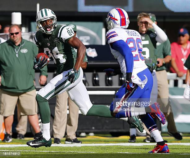 Wide receiver Stephen Hill runs after making a catch for a first down as cornerback Justin Rogers of the Buffalo Bills chases him during the first...