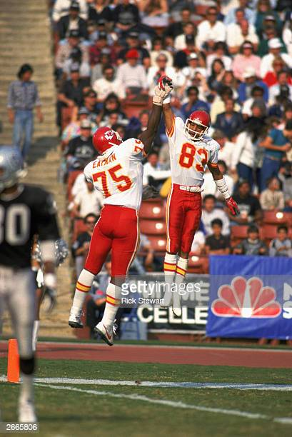 Wide receiver Stephone Paige and Irv Eatman of the Kansas City Chiefs celebrate with a high five during a 1986 NFL game against the Los Angeles...