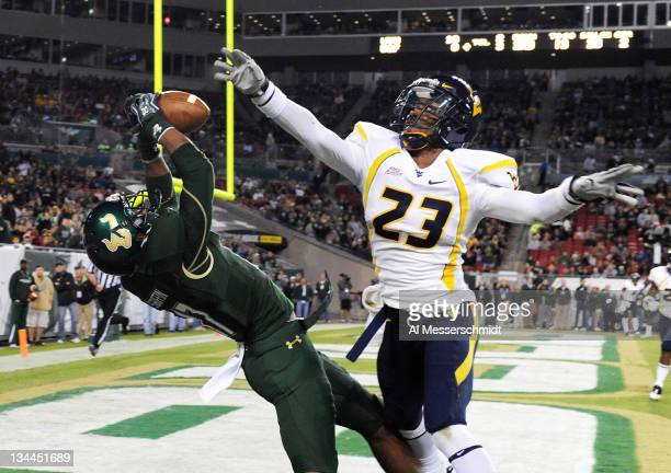 Wide receiver Sterling Griffin of the South Florida Bulls grabs a second-quarter touchdown pass over defensive back Broderick Jenkins of the West...