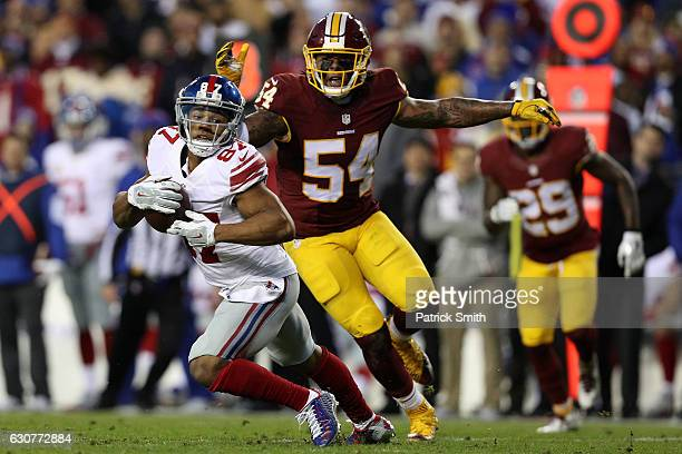 Wide receiver Sterling Shepard of the New York Giants carries the ball past inside linebacker Mason Foster of the Washington Redskins in the second...