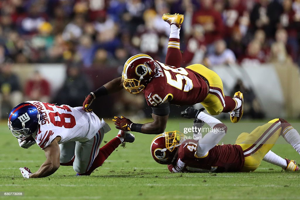 Wide receiver Sterling Shepard #87 of the New York Giants is tackled by outside linebacker Martrell Spaight #50 and free safety Will Blackmon #41 of the Washington Redskins in the second quarter at FedExField on January 1, 2017 in Landover, Maryland.