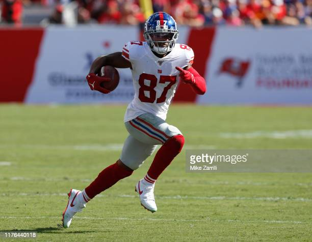 Wide receiver Sterling Shepard of the New York Giants runs with the ball after a reception during the game against the Tampa Bay Buccaneers at...