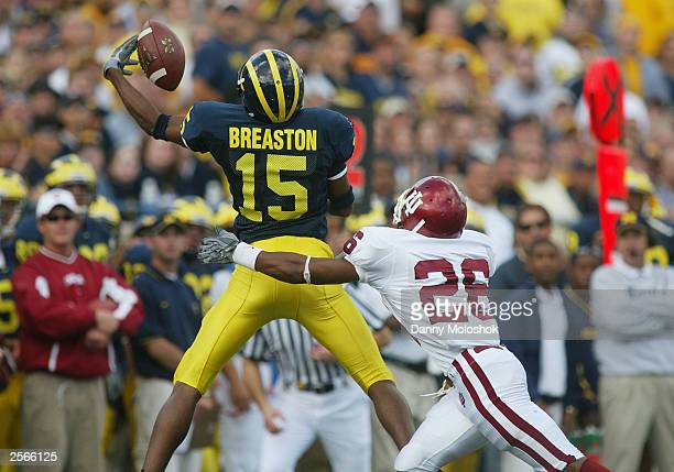 Wide receiver Steve Breaston of the University of Michigan Wolverines tries make a one handed catch above defensive back Leonard Bryant of the...