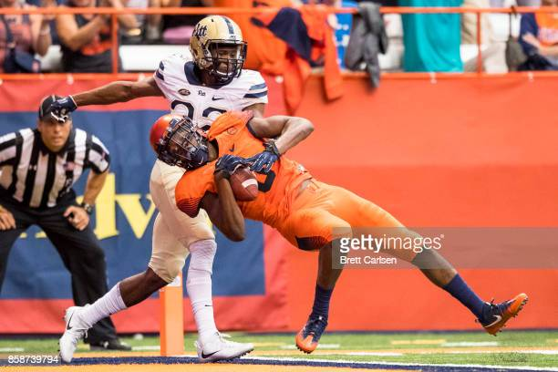 Wide receiver Steve Ishmael of the Syracuse Orange makes a touchdown reception during the second half against the Pittsburgh Panthers at the Carrier...