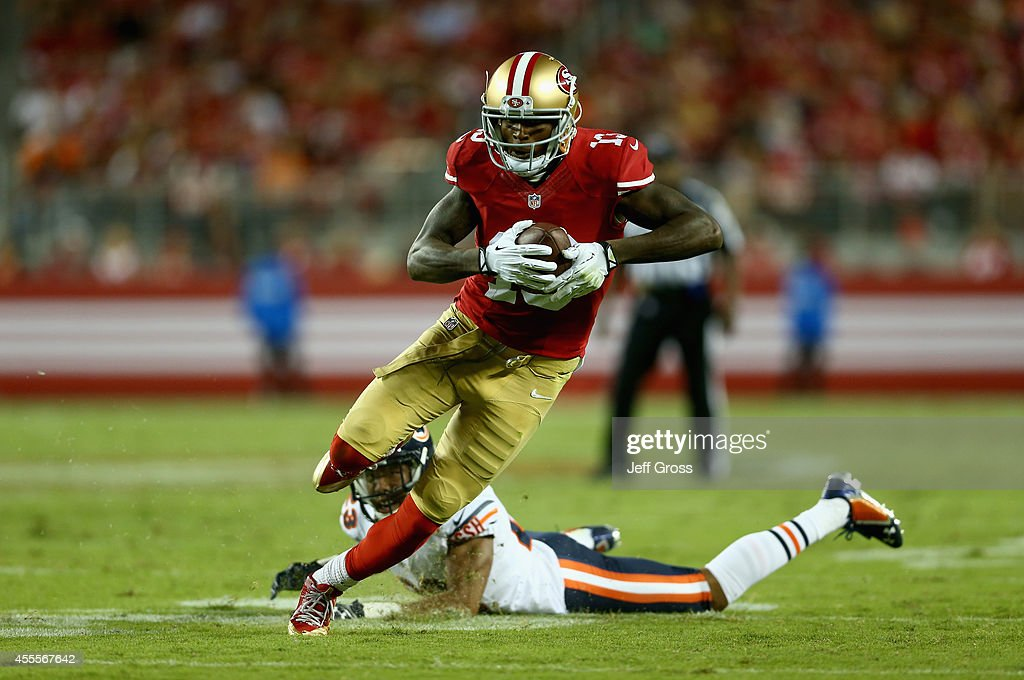 Wide receiver Steve Johnson #13 of the San Francisco 49ers breaks the tackle of cornerback Kyle Fuller #23 of the Chicago Bears at Levi's Stadium on September 14, 2014 in Santa Clara, California.