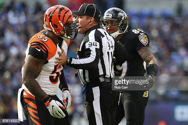Wide receiver Steve Smith of the Baltimore Ravens and outside linebacker Vontaze Burfict of the Cincinnati Bengals are seperated by referee Clete...