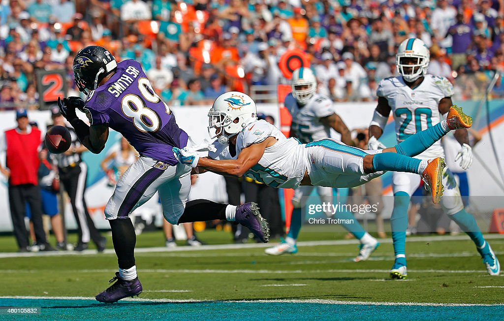 Wide receiver Steve Smith #89 of the Baltimore Ravens can't catch a pass in the end zone in the second quarter as cornerback Brent Grimes #21 of the Miami Dolphins defends during a game at Sun Life Stadium on December 7, 2014 in Miami Gardens, Florida.