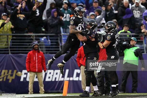Wide receiver Steve Smith of the Baltimore Ravens celebrates with teammate guard Marshal Yanda after scoring a second quarter touchdown against the...