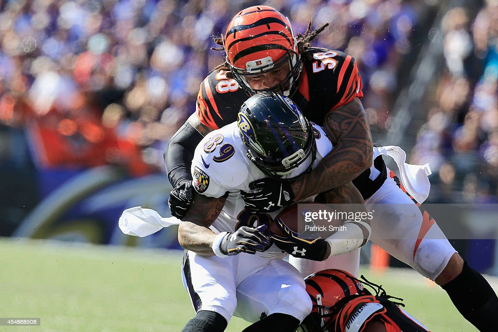 Wide receiver Steve Smith #89 of the Baltimore Ravens is tackled by middle linebacker Rey Maualuga #58 of the Cincinnati Bengals during an NFL football game at M&T Bank Stadium on September 7, 2014 in Baltimore, Maryland.