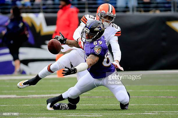 Wide receiver Steve Smith of the Baltimore Ravens is unable to make the catch against the defense of cornerback Joe Haden of the Cleveland Browns in...