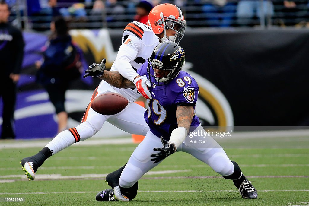 Wide receiver Steve Smith #89 of the Baltimore Ravens is unable to make the catch against the defense of cornerback Joe Haden #23 of the Cleveland Browns in the first quarter of a game at M&T Bank Stadium on December 28, 2014 in Baltimore, Maryland.