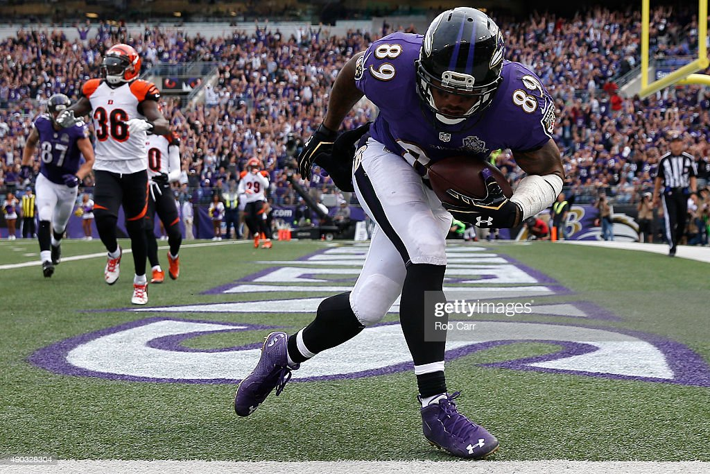 Wide receiver Steve Smith #89 of the Baltimore Ravens scores a fourth quarter touchdown during a game against the Cincinnati Bengals at M&T Bank Stadium on September 27, 2015 in Baltimore, Maryland.