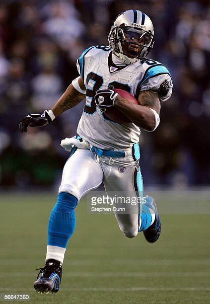 Wide receiver Steve Smith of the Carolina Panthers scores a touchdown in second quarter action against the Seattle Seahawks during the NFC...