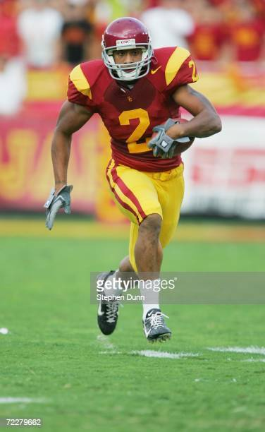 Wide receiver Steve Smith of the USC Trojans carries the ball against the Arizona State Sun Devils at the Los Angeles Memorial Coliseum on October 14...