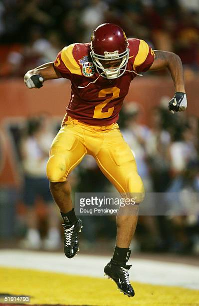 Wide receiver Steve Smith of the USC Trojans celebrates after catching a 5yard touchdown pass against the Oklahoma Sooners in the second quarter...