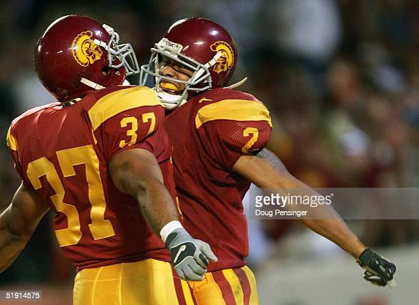 Wide receiver Steve Smith of the USC Trojans celebrates with teammate David Kirtman after catching a 5yard touchdown pass against the Oklahoma...