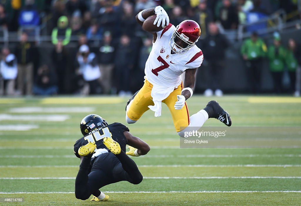 Wide receiver Steven Mitchell Jr. #7 of the USC Trojans leaps over cornerback Ugo Amadi #14 of the Oregon Ducks during the third quarter of the game at Autzen Stadium on November 21, 2015 in Eugene, Oregon. The Ducks won the game 48-28.