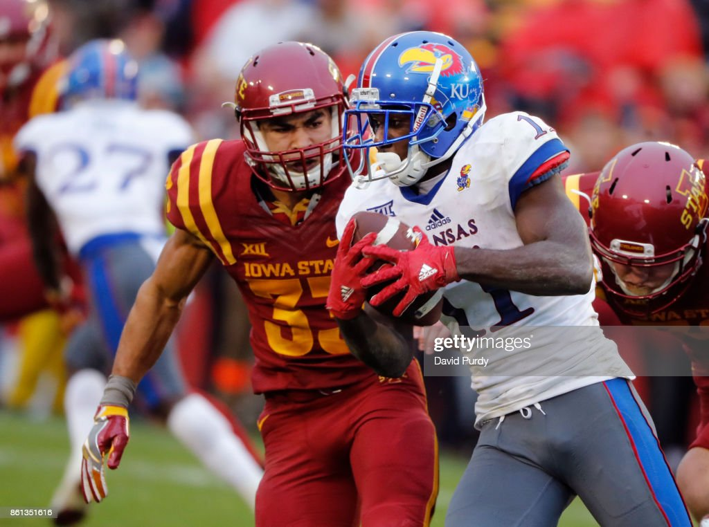 Wide receiver Steven Sims Jr. #11 of the Kansas Jayhawks is tackled by defensive back Braxton Lewis #33 of the Iowa State Cyclones as he rushed for yards in the second half of play at Jack Trice Stadium on October 14, 2017 in Ames, Iowa. The Iowa State Cyclones won 45-0 over the Kansas Jayhawks.